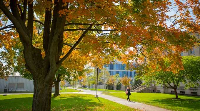 Student walking on UB South Campus.